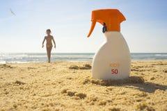 Sunblock cream with Sun Protection Factor or SPF 50 on beach san stock photography