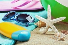 Sunblock and stuff for the beach. Focus on starfish Stock Photos