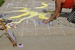 Sunburned chalk artist Stock Photo