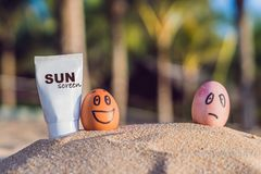 Sunburned egg smeared the sun screen, and the burnt egg was not smeared. Burned in the sun, cream from the sun royalty free stock images