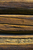 Sunburned timbered wall. Sunburned old timbered wall from a log house barn in Norway royalty free stock images