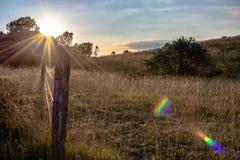 Sunburst над загородкой выгона Стоковое фото RF