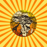 Sunburst with African symbols background Stock Images