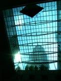 Sunburst através do vidro do prédio de escritórios Foto de Stock Royalty Free