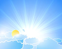 Sunburst background with clouds Stock Photo