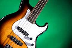 Sunburst Bass Guitar Iolated on Green Royalty Free Stock Photo