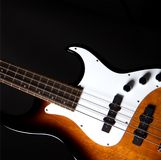 Sunburst Bass Guitar Isolated On Black Stock Photo