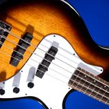 Sunburst Bass Guitar Isolated On Blue Royalty Free Stock Photos