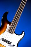 Sunburst Bass Guitar Isolated On Blue Royalty Free Stock Photography