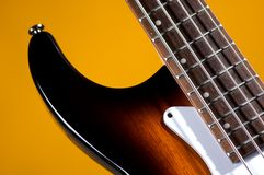 Sunburst Bass Guitar Isolated On Gold Royalty Free Stock Photos