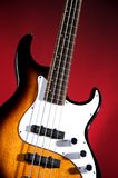 Sunburst Bass Guitar Isolated On Red Royalty Free Stock Image