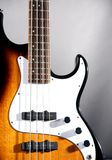Sunburst Bass Guitar on Smoke Bk Stock Image