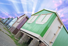 Sunburst beach huts Royalty Free Stock Image