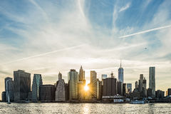 Sunburst between buildings of the Manhattan skyline in New York City Royalty Free Stock Photo