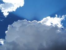 Sunburst through clouds Stock Photos