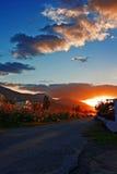 Sunburst through clouds on country lane Royalty Free Stock Photo