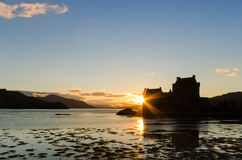 Sunburst on Eilean Donan castle Stock Images