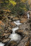 Sunburst Falls. North Carolina. Beautiful cascading waterfall right along NC 215 just a few miles north of the Blue Ridge Parkway. Seen here with autumn colors stock photos