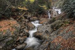 Sunburst Falls. North Carolina. Beautiful cascading waterfall right along NC 215 just a few miles north of the Blue Ridge Parkway. Seen here with autumn colors stock photo