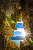 Sunburst i Tufa Royaltyfri Fotografi