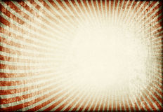 Sunburst image on old grunge paper background. Royalty Free Stock Photo