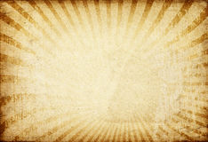 Sunburst image on vintage paper background. Stock Photo