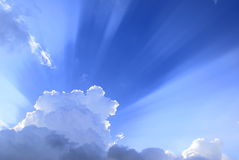 Sunburst light over clouds Royalty Free Stock Image