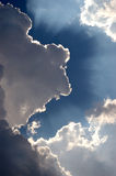 Sunburst out of clouds Stock Photo