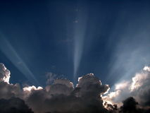 Sunburst over clouds. Sun light streaming over the tops of clouds Stock Image