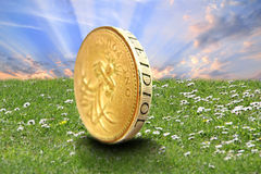 Sunburst over gold coin Stock Image