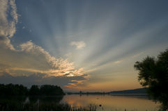Sunburst over Lake Stock Images