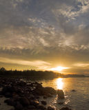 Sunburst over Rocky Beach Royalty Free Stock Photos