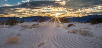 Sunburst Over Sand Dunes stock photos