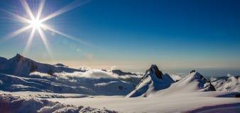 Sunburst. Panoramic Composition Of Sunburst Over Fox Glacier Névé, Westland Tai Poutini Natinal Park, West, Coast South Island, New Zealand Royalty Free Stock Images