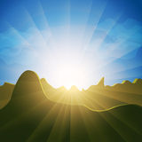 Sunburst rays over mountain tops Stock Photography