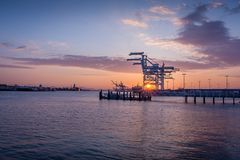 Oakland shipping cranes at dusk stock image
