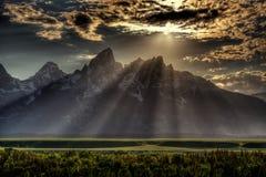 Sunburst sobre Tetons grande Imagens de Stock