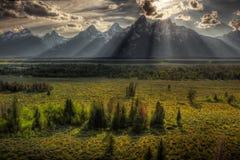 Sunburst sobre Tetons grande Fotos de Stock Royalty Free