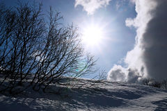 Sunbust in winter with clouds Stock Photography