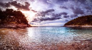 Mali Losinj sunset at the beach. Suncana Uvala in Mali losinj in wintertime with beautiful beach and stormy clouds Royalty Free Stock Image