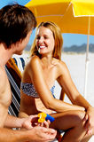 Suncare couple Stock Images