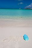 Suncare written on tropical white sand and. Suncare written on tropical white sand Stock Photo