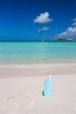 Suncare written on tropical white sand and Royalty Free Stock Photos