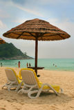 Sunchairs and umbrella on the. Sunchairs and umbrellas on beach in Phuket Royalty Free Stock Images