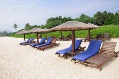 Sunchairs and umbrellas on the beach. At Yalong bay,Sanya,Hainan,China Stock Photography