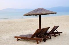 Sunchairs and umbrellas on the beach. In Yalong bay, Sanya, Hainan, China Stock Photos