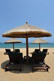 Sunchairs and umbrellas on the beach. Located in  Sanya, Hainan, China Stock Photo