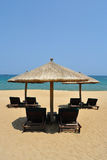 Sunchairs and umbrellas on the beach. Located in  Sanya, Hainan, China Royalty Free Stock Images