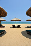 Sunchairs and umbrellas on the beach Royalty Free Stock Photography