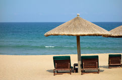 Sunchairs and umbrellas on the beach. Located in  Sanya, Hainan, China Royalty Free Stock Image